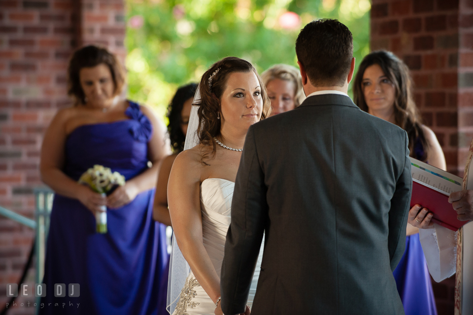 Bride looking at Groom during wedding ceremony. Harbour View Events Woodbridge Virginia wedding ceremony and reception photo, by wedding photographers of Leo Dj Photography. http://leodjphoto.com