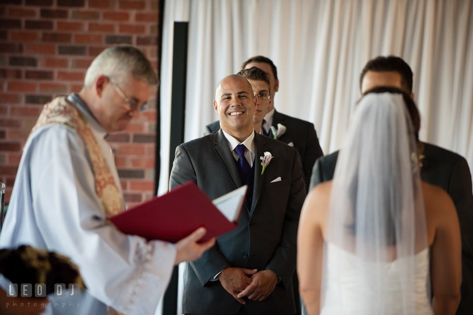 Best man smiling during wedding vow. Harbour View Events Woodbridge Virginia wedding ceremony and reception photo, by wedding photographers of Leo Dj Photography. http://leodjphoto.com