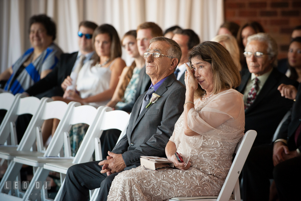 Groom's Mother and Father shed tear during wedding ceremony. Harbour View Events Woodbridge Virginia wedding ceremony and reception photo, by wedding photographers of Leo Dj Photography. http://leodjphoto.com