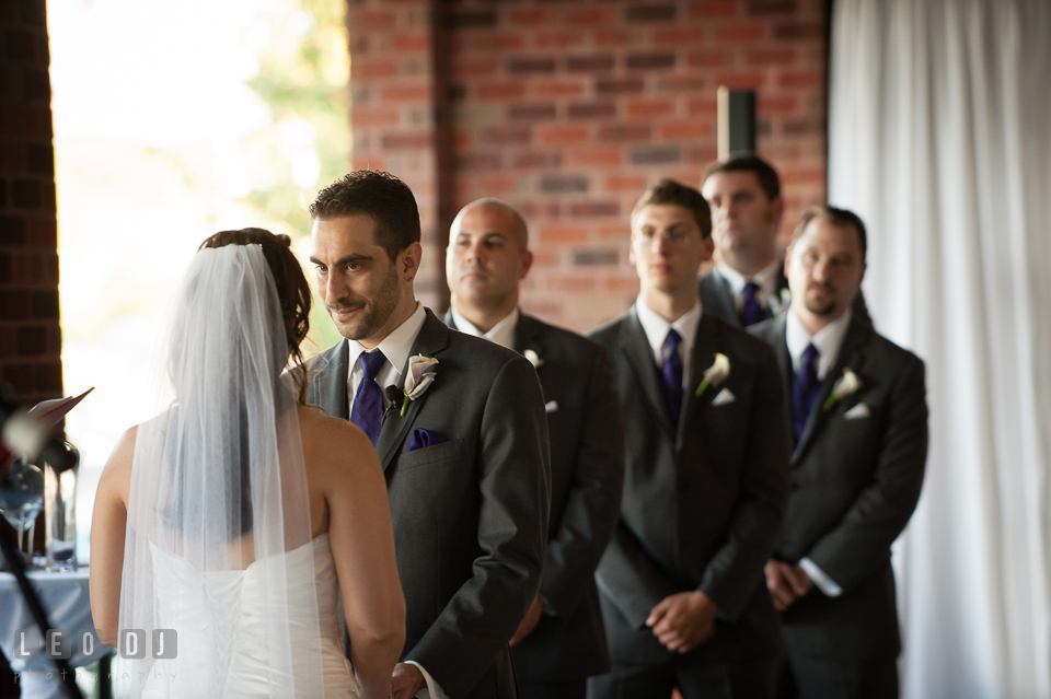 Groom looking at the Bride during wedding ceremony. Harbour View Events Woodbridge Virginia wedding ceremony and reception photo, by wedding photographers of Leo Dj Photography. http://leodjphoto.com