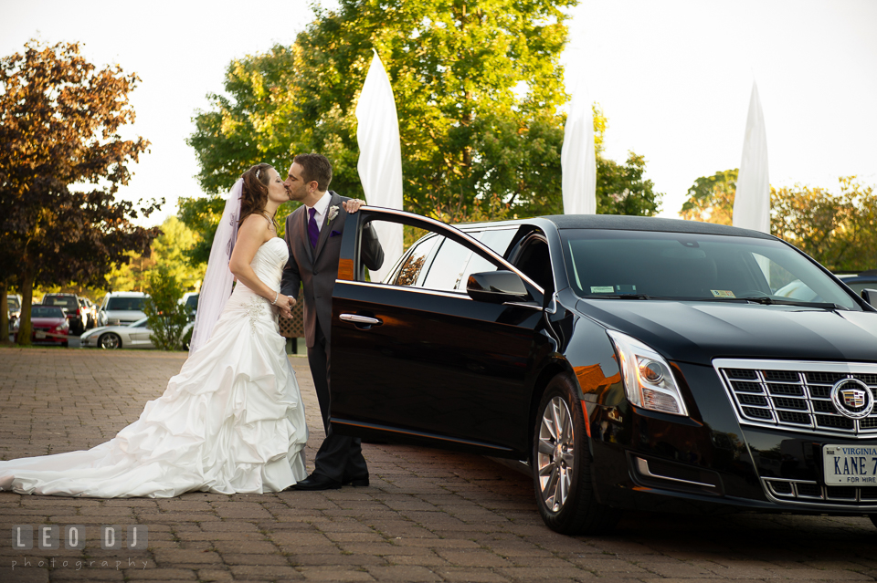 Bride and Groom kissing in front of Limo. Harbour View Events Woodbridge Virginia wedding ceremony and reception photo, by wedding photographers of Leo Dj Photography. http://leodjphoto.com