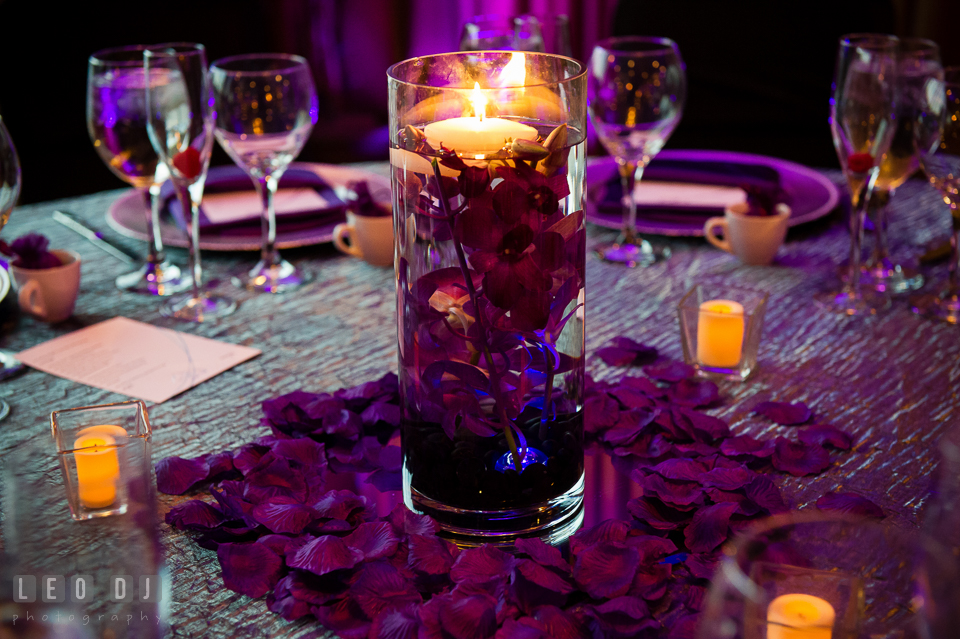 Table centerpieces with purple orchid blooms from DaVinci Florist. Harbour View Events Woodbridge Virginia wedding ceremony and reception photo, by wedding photographers of Leo Dj Photography. http://leodjphoto.com