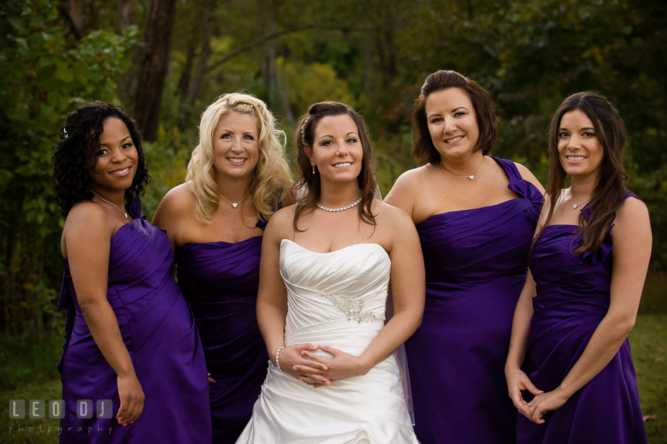 Bride posing with her Bride's party, consisting the Maid of Honor and Bridesmaids. Harbour View Events Woodbridge Virginia wedding ceremony and reception photo, by wedding photographers of Leo Dj Photography. http://leodjphoto.com