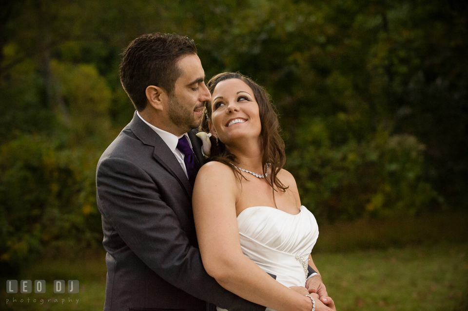 The Bride and Groom hugging. Harbour View Events Woodbridge Virginia wedding ceremony and reception photo, by wedding photographers of Leo Dj Photography. http://leodjphoto.com