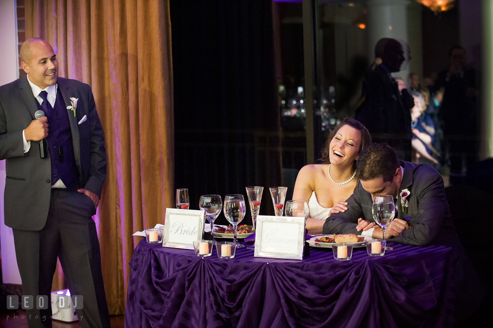 Bride and Groom laughing to toast speeches from Best Man. Harbour View Events Woodbridge Virginia wedding ceremony and reception photo, by wedding photographers of Leo Dj Photography. http://leodjphoto.com