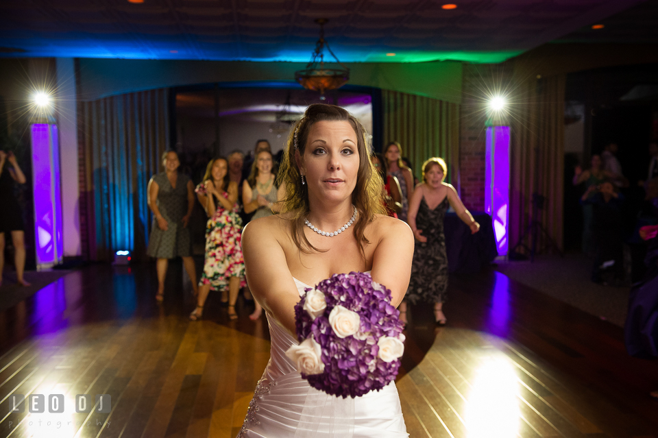 Bride getting ready to toss her wedding bouquet. Harbour View Events Woodbridge Virginia wedding ceremony and reception photo, by wedding photographers of Leo Dj Photography. http://leodjphoto.com