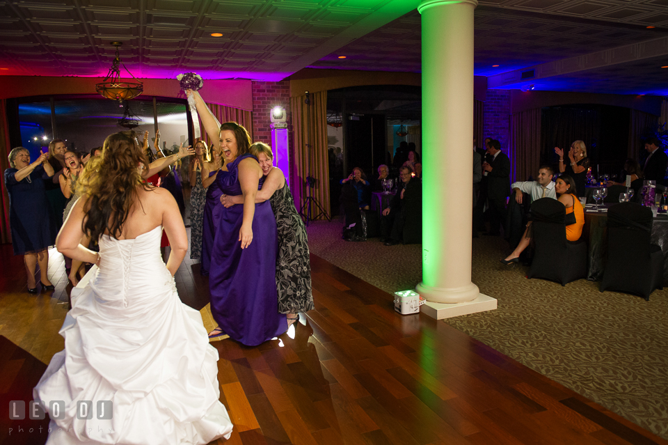 The winner who caught the bouquet toss was one of the Bridesmaid. Harbour View Events Woodbridge Virginia wedding ceremony and reception photo, by wedding photographers of Leo Dj Photography. http://leodjphoto.com