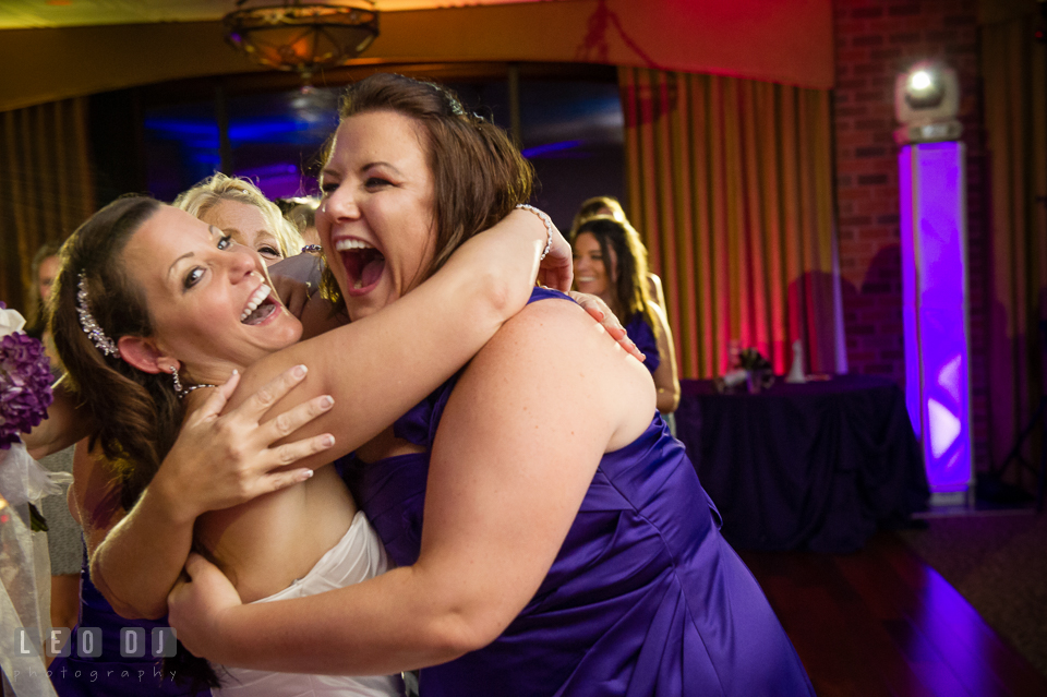 Bride hugging winner of the bouquet tossing. Harbour View Events Woodbridge Virginia wedding ceremony and reception photo, by wedding photographers of Leo Dj Photography. http://leodjphoto.com
