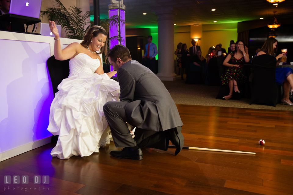 Groom looking for Bride's garter belt but found billiard balls and cue sticks instead. Harbour View Events Woodbridge Virginia wedding ceremony and reception photo, by wedding photographers of Leo Dj Photography. http://leodjphoto.com