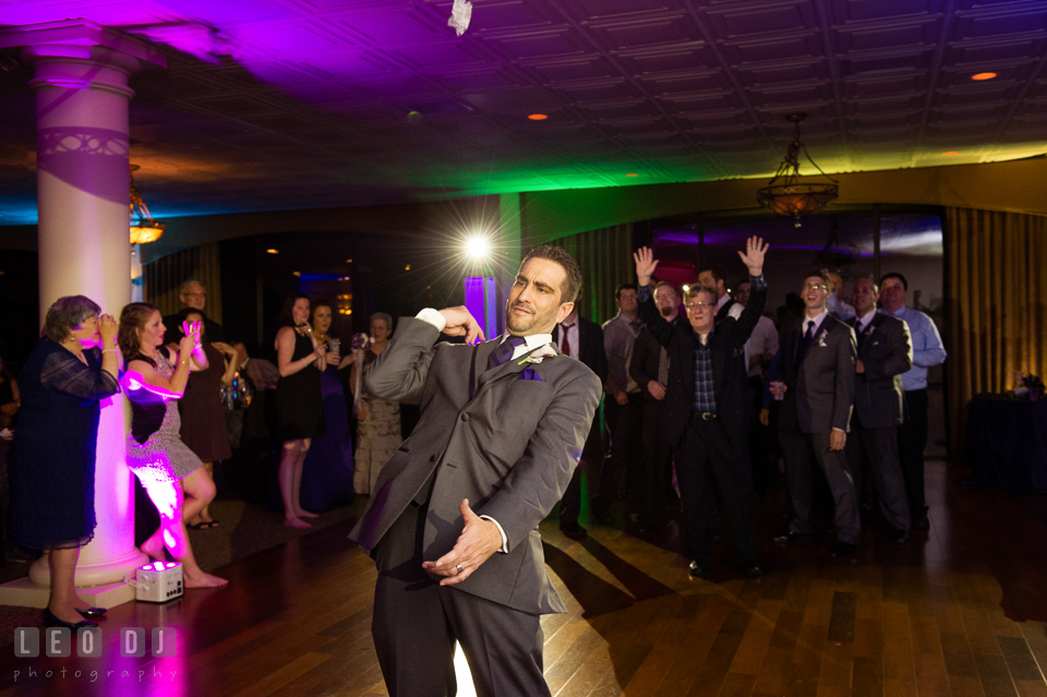 Groom tossing the garter. Harbour View Events Woodbridge Virginia wedding ceremony and reception photo, by wedding photographers of Leo Dj Photography. http://leodjphoto.com