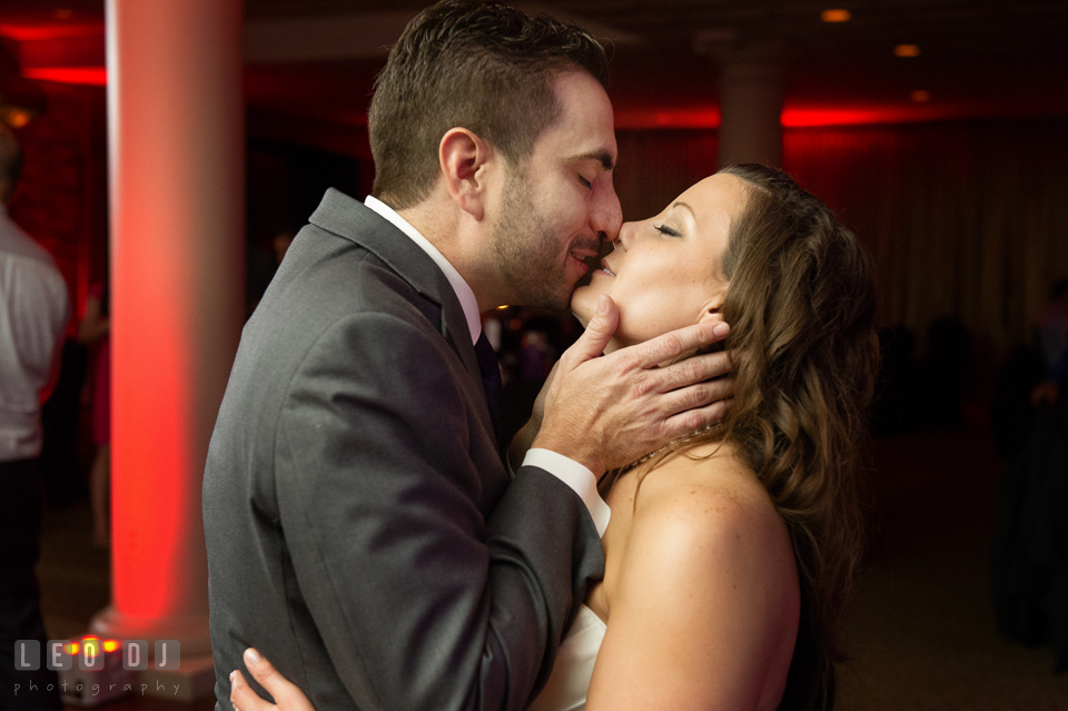 Kiss from the Groom to the Bride during open dance. Harbour View Events Woodbridge Virginia wedding ceremony and reception photo, by wedding photographers of Leo Dj Photography. http://leodjphoto.com