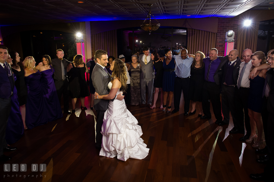 Bride and Groom dancing together with guests circling them. Harbour View Events Woodbridge Virginia wedding ceremony and reception photo, by wedding photographers of Leo Dj Photography. http://leodjphoto.com