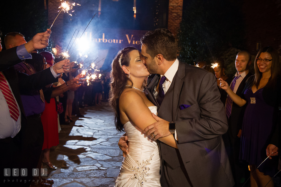 Bride and Groom kissing during grand exit with sparklers. Harbour View Events Woodbridge Virginia wedding ceremony and reception photo, by wedding photographers of Leo Dj Photography. http://leodjphoto.com