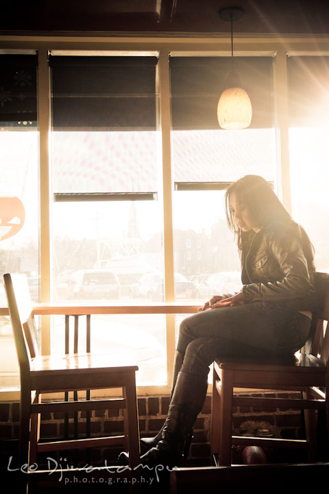 Engaged girl waiting for her fiancé in a coffee shop. City or urban setting pre-wedding or engagement photo session at Annapolis, by Annapolis wedding photographer, Leo Dj Photography.