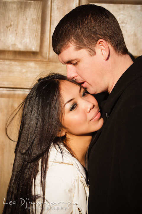 Engaged girl leaning her head on her fiancé's chest. City or urban setting pre-wedding or engagement photo session at Annapolis, by Annapolis wedding photographer, Leo Dj Photography.