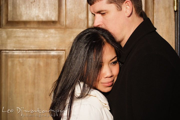 Engaged guy kissed his fiancée's hair. City or urban setting pre-wedding or engagement photo session at Annapolis, by Annapolis wedding photographer, Leo Dj Photography.