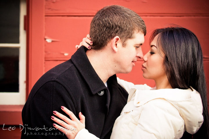 Engaged couple holding close and rubbing their noses. City or urban setting pre-wedding or engagement photo session at Annapolis, by Annapolis wedding photographer, Leo Dj Photography.