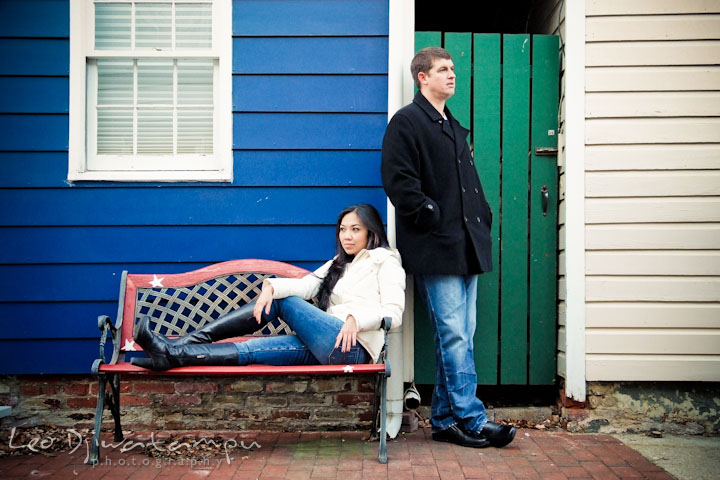 Engaged couple posing by a blue house and green door. City or urban setting pre-wedding or engagement photo session at Annapolis, by Annapolis wedding photographer, Leo Dj Photography.