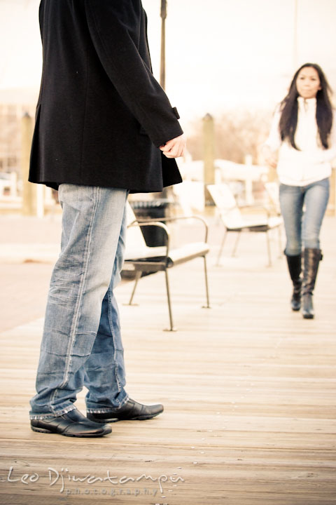 Girl walking toward a guy. City or urban setting pre-wedding or engagement photo session at Annapolis, by Annapolis wedding photographer, Leo Dj Photography.