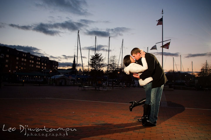 Engaged couple doing the dip during an evening sunset sky. City or urban setting pre-wedding or engagement photo session at Annapolis, by Annapolis wedding photographer, Leo Dj Photography.