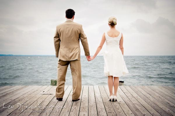 bride groom at pier/dock looking at water at chesapeake bay. Annapolis Kent Island MD Modern Intimate Candid Posed Photojournalistic Style Wedding Photographer
