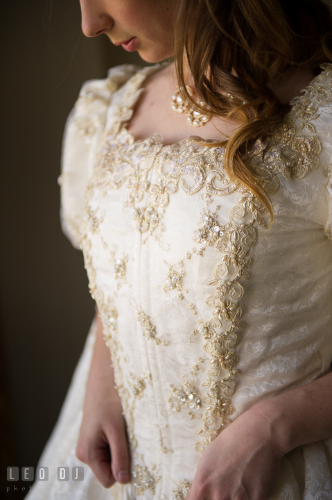 Detail shot of Bride's Renaissance style wedding gown. Baltimore Maryland Science Center wedding, getting ready photo at Royal Sonesta Harbor Court hotel, by wedding photographers of Leo Dj Photography. http://leodjphoto.com