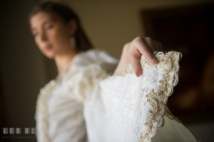 Detail shot of the wedding gown sleeves. Baltimore Maryland Science Center wedding, getting ready photo at Royal Sonesta Harbor Court hotel, by wedding photographers of Leo Dj Photography. http://leodjphoto.com