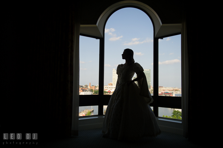 Silhouette of Bride in her Rennaisance style wedding gown. Baltimore Maryland Science Center wedding, getting ready photo at Royal Sonesta Harbor Court hotel, by wedding photographers of Leo Dj Photography. http://leodjphoto.com