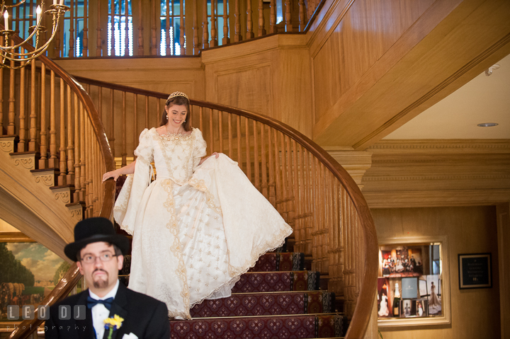 Bride quietly coming down the stairs excited to meet Groom. Baltimore Maryland Science Center wedding, getting ready photo at Royal Sonesta Harbor Court hotel, by wedding photographers of Leo Dj Photography. http://leodjphoto.com