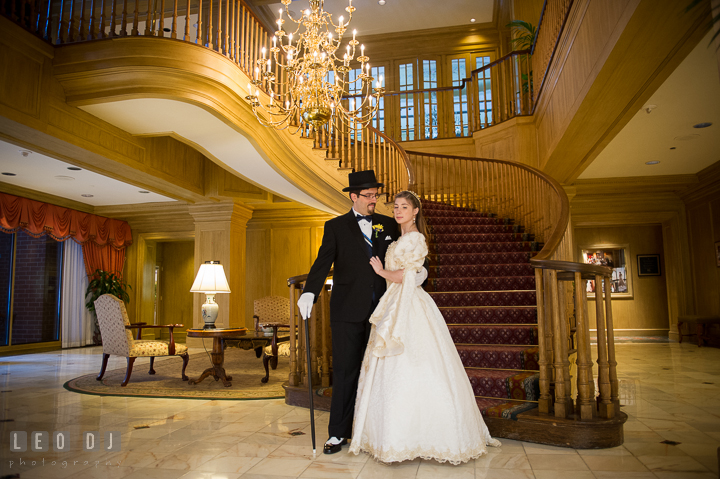 Bride and Groom posing at the beautiful grand lobby. Baltimore Maryland Science Center wedding, getting ready photo at Royal Sonesta Harbor Court hotel, by wedding photographers of Leo Dj Photography. http://leodjphoto.com