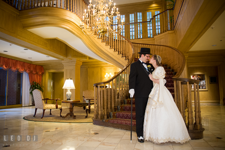 Bride and Groom cuddling at the beautiful hotel lobby. Baltimore Maryland Science Center wedding, getting ready photo at Royal Sonesta Harbor Court hotel, by wedding photographers of Leo Dj Photography. http://leodjphoto.com