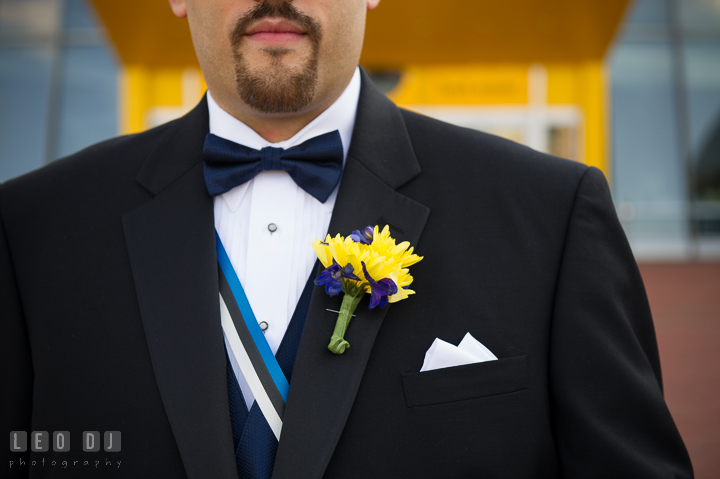 Close up of Groom's tux, ribbon, bow tie, and boutonniere. Baltimore Maryland Science Center wedding reception and ceremony photo, by wedding photographers of Leo Dj Photography. http://leodjphoto.com