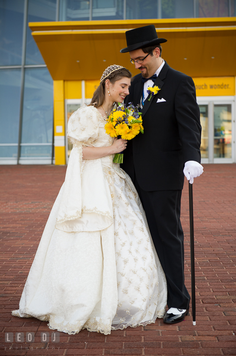 Groom hugging Bride and smiling together. Baltimore Maryland Science Center wedding reception and ceremony photo, by wedding photographers of Leo Dj Photography. http://leodjphoto.com
