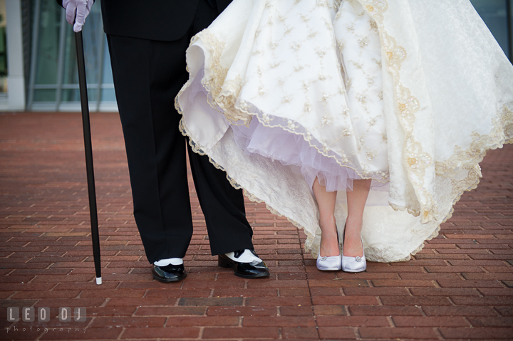 Detail shot of Bride and Groom shoes, and Groom's cane. Baltimore Maryland Science Center wedding reception and ceremony photo, by wedding photographers of Leo Dj Photography. http://leodjphoto.com