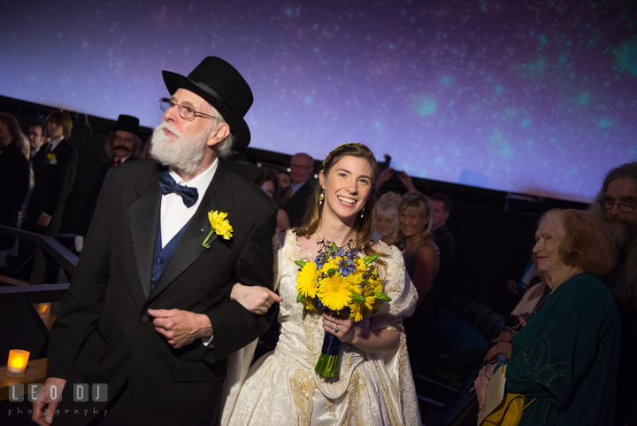 Father of the Bride escorting daughter for ceremony procession. Baltimore Maryland Science Center wedding reception and ceremony photo, by wedding photographers of Leo Dj Photography. http://leodjphoto.com