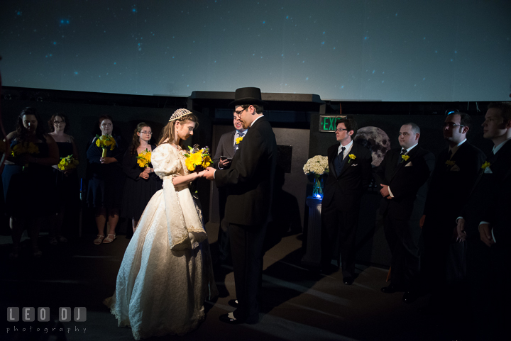 Bride and Groom holding hands during ceremony. Baltimore Maryland Science Center wedding reception and ceremony photo, by wedding photographers of Leo Dj Photography. http://leodjphoto.com