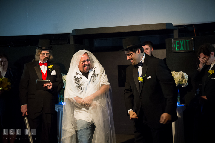 A male guests disguises as fake Bride. Baltimore Maryland Science Center wedding reception and ceremony photo, by wedding photographers of Leo Dj Photography. http://leodjphoto.com
