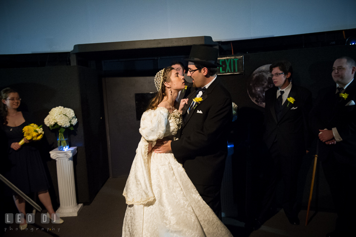 Groom almost kissed the evil twin Bride. Baltimore Maryland Science Center wedding reception and ceremony photo, by wedding photographers of Leo Dj Photography. http://leodjphoto.com