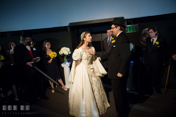 Groom realized that she was not the real one but the Bride's evil twin. Baltimore Maryland Science Center wedding reception and ceremony photo, by wedding photographers of Leo Dj Photography. http://leodjphoto.com