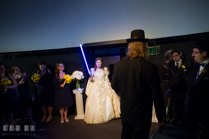 The real Bride came to rescue Groom from the evil lord. Baltimore Maryland Science Center wedding reception and ceremony photo, by wedding photographers of Leo Dj Photography. http://leodjphoto.com