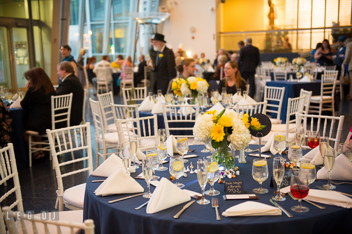 Table settings and view of the main hall. Baltimore Maryland Science Center wedding reception and ceremony photo, by wedding photographers of Leo Dj Photography. http://leodjphoto.com