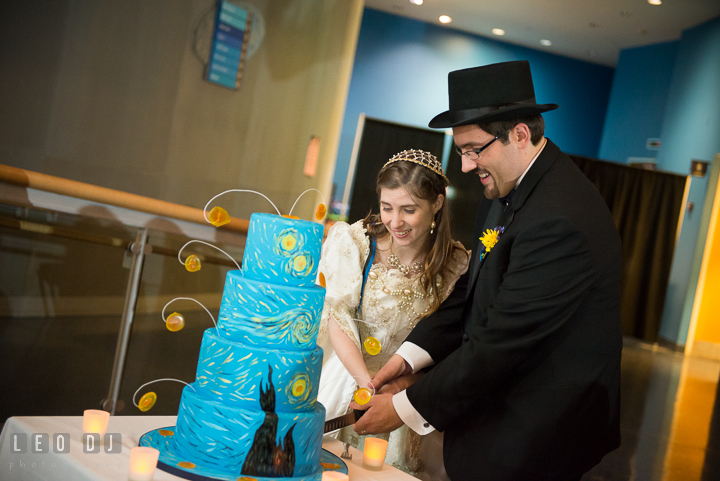 Bride and Groom cutting the wedding cake. Baltimore Maryland Science Center wedding reception and ceremony photo, by wedding photographers of Leo Dj Photography. http://leodjphoto.com