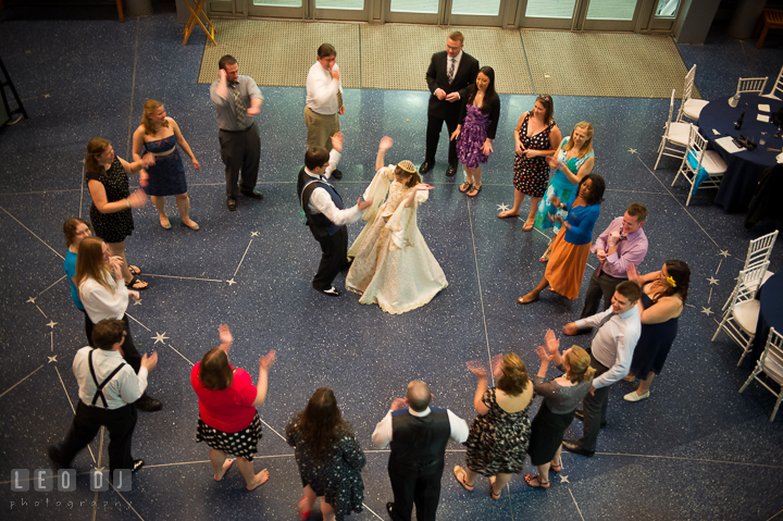 Bride and Groom dancing and circled by guests. Baltimore Maryland Science Center wedding reception and ceremony photo, by wedding photographers of Leo Dj Photography. http://leodjphoto.com