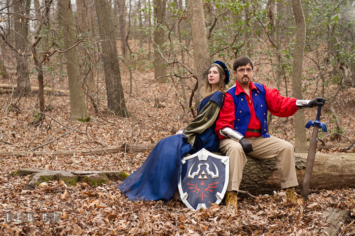 Engaged guy and his fiancée holding Zelda sword and shield. Renaissance Costume Cosplay fun theme pre-wedding engagement photo session at Maryland, by wedding photographers of Leo Dj Photography. http://leodjphoto.com