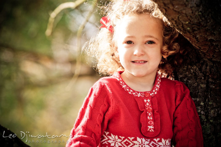 cute girl with curly hair, red ribon and red dress. Candid children photographer St Michael Tilghman Island MD