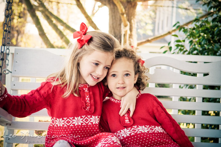 sisters hugging, smiling. Candid children photographer St Michael Tilghman Island MD