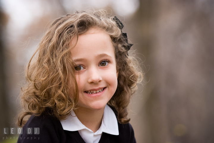 Cute curly girl smiling. Washington DC fun and candid children lifestyle photo session of Helena and Vivian by photographers of Leo Dj Photography.