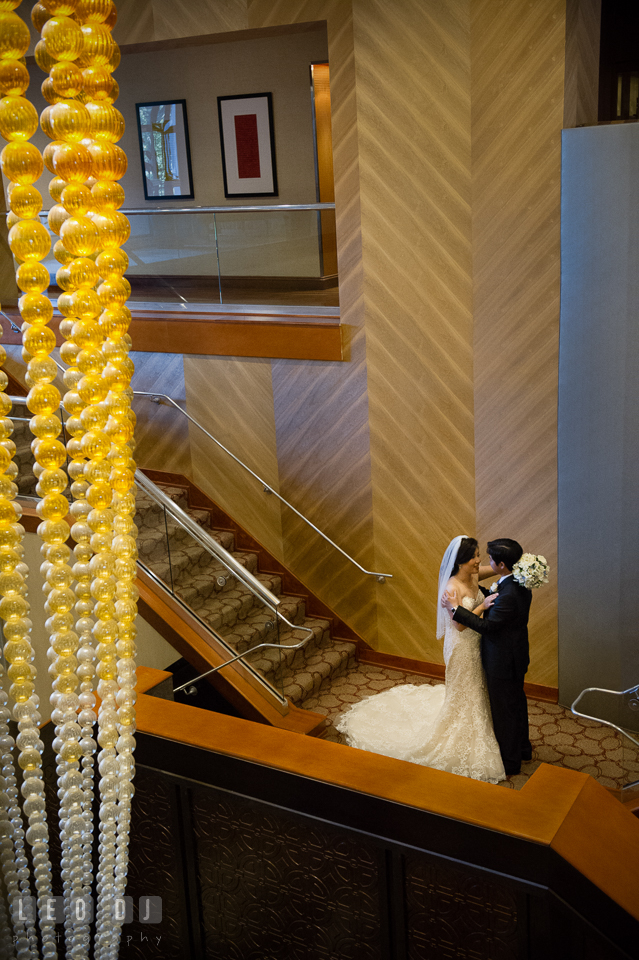 Sheraton Hotel Reston Virginia Bride and Groom hugging on the stairs photo by Leo Dj Photography