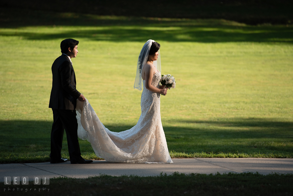Hidden Creek Country Club Groom holding Bride's dress train photo by Leo Dj Photography