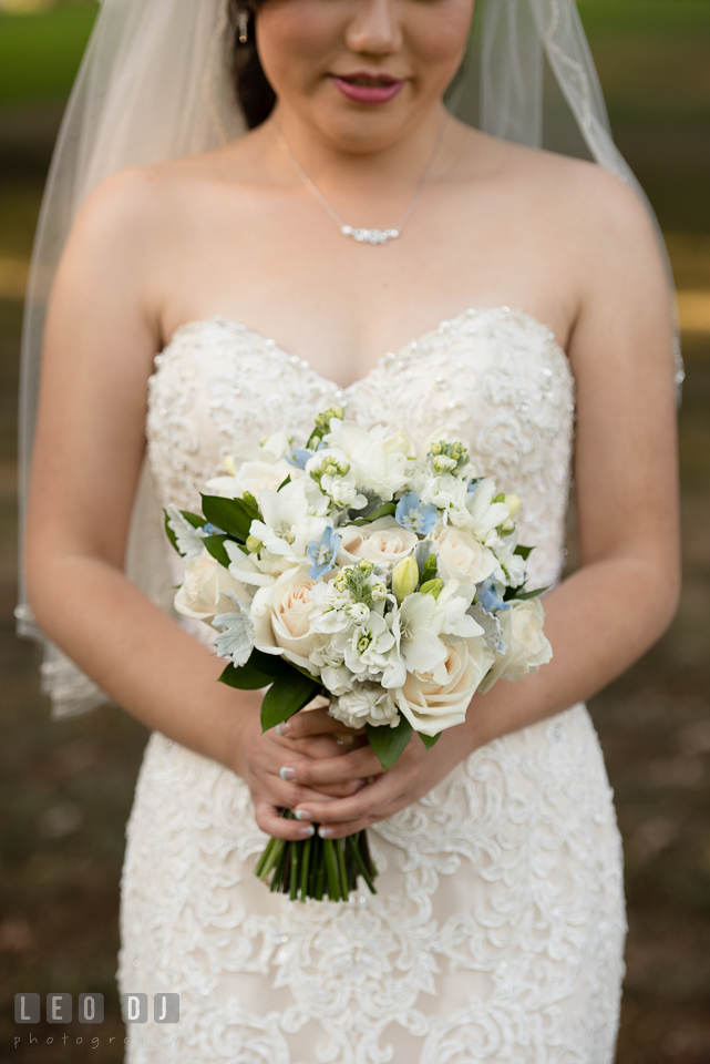 Hidden Creek Country Club Bride holding bouquet by Maryam Flowers photo by Leo Dj Photography